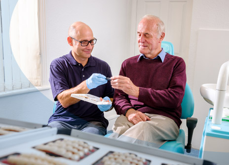 Working with a patient to choose the right dentures
